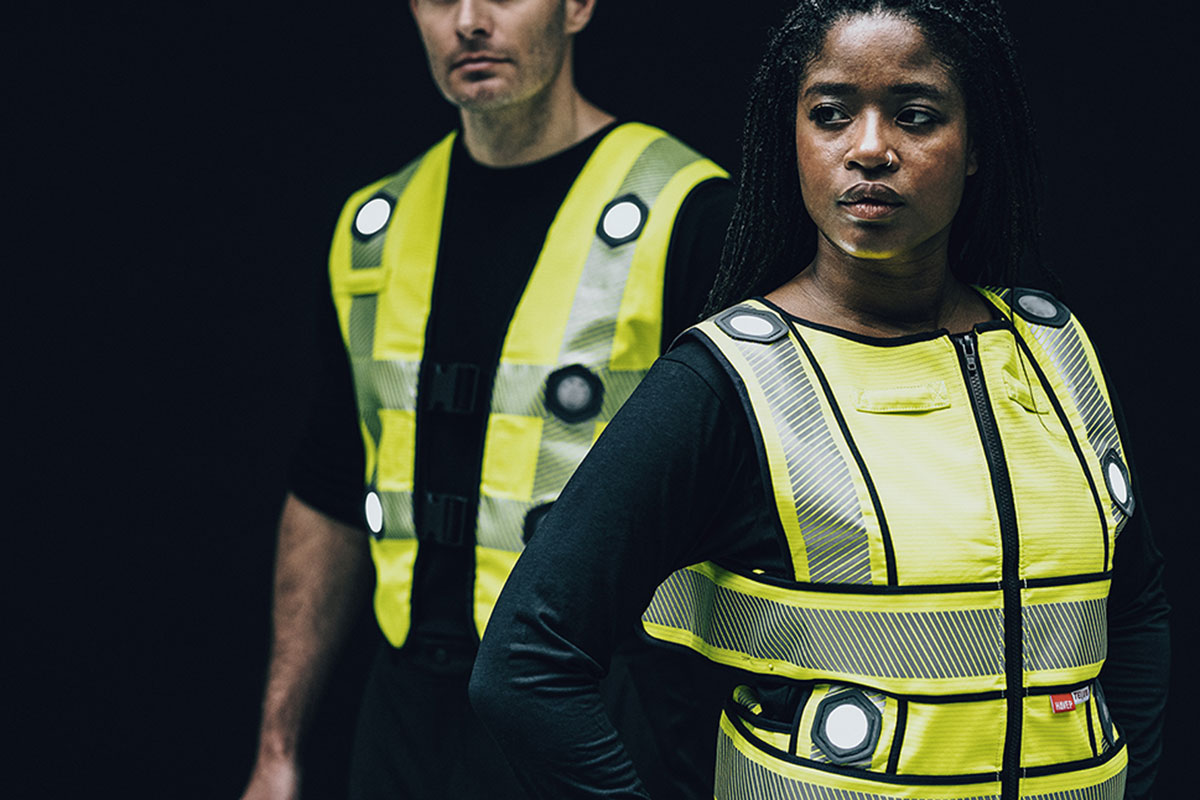 A woman and a man wearing smart safety vests