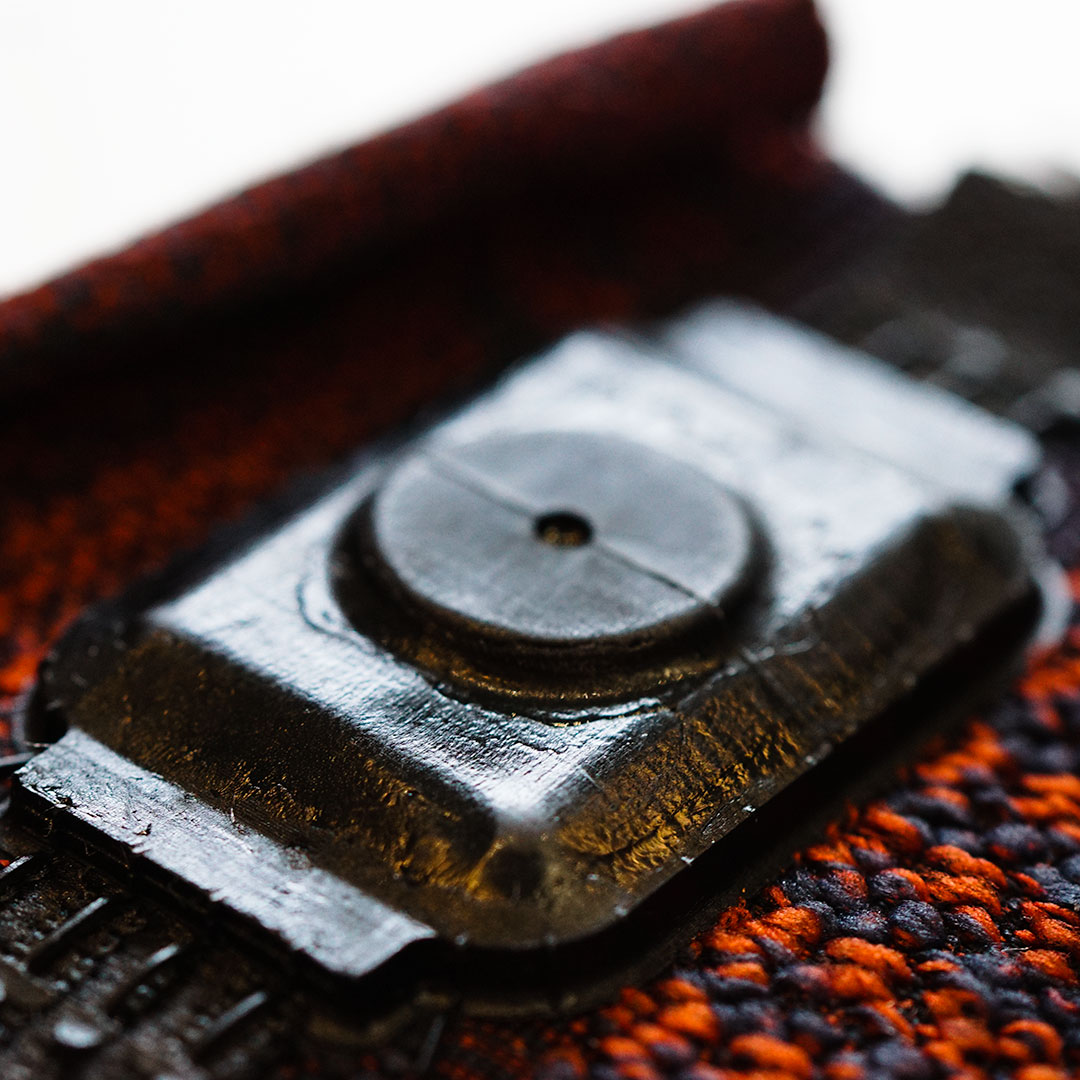 Overmoulded material on textile
